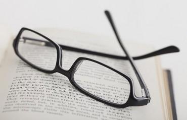 studio-shot-of-reading-glasses-on-book-vstock-llc